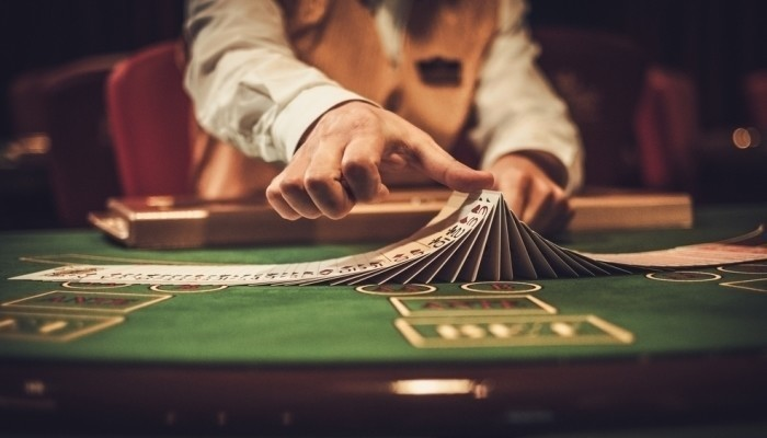 croupier playing with cards in casino
