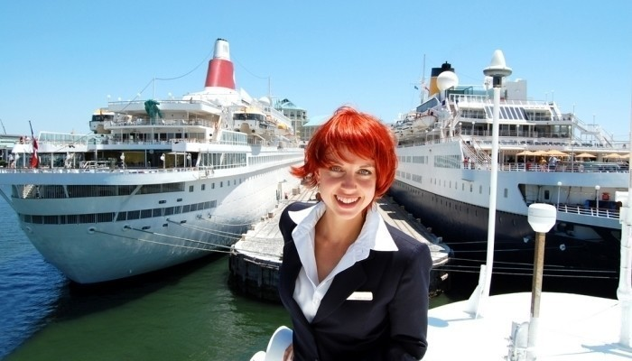 female crew member on the top deck of a cruise ship