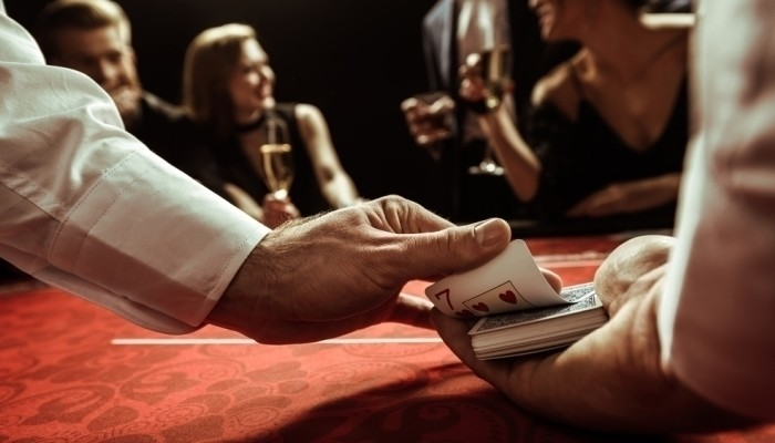 casino dealer shuffling cards