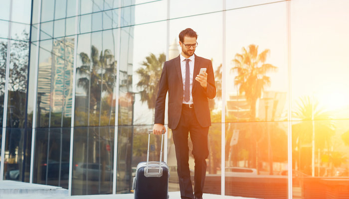 Travelling businessman with suitcase