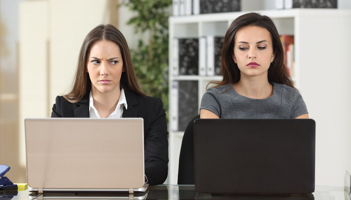Two annoyed female colleagues