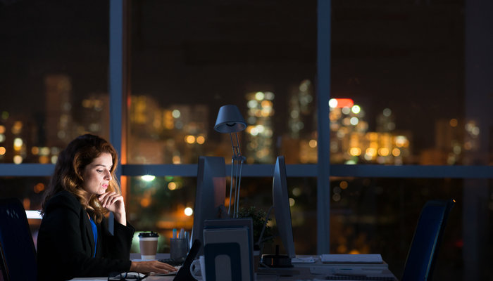 Woman working late in office