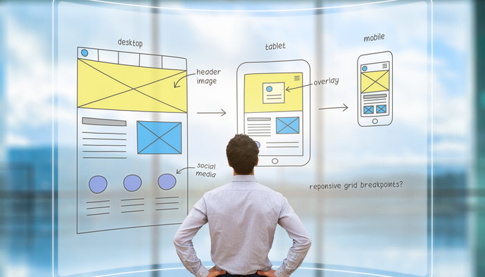 Businessman reviewing website wireframes