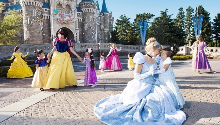 Costumed characters with young children at Disneyland