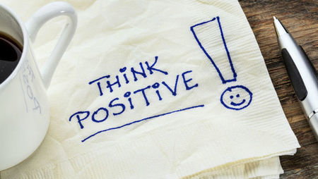 Think positive text written on a tissue with pen