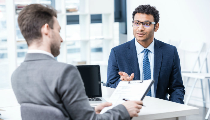 A young man attending a job interview with a male hiring manager