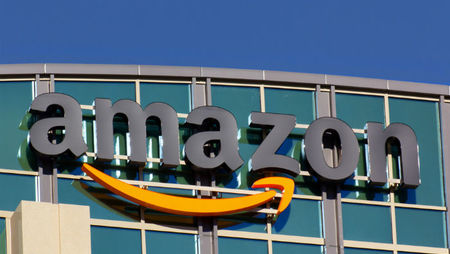 Glass building exterior with large Amazon logo