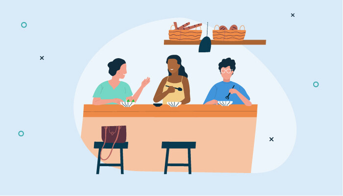 Illustration of people having lunch on a table