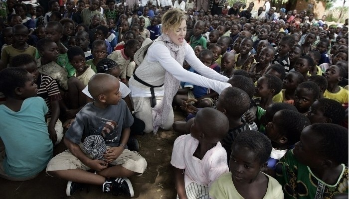 madaonna in malawi doing charity work